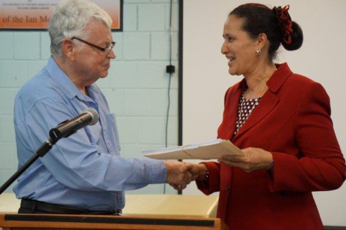 Ian McDonald hands over 100 unpublished poems to Elmelinda Lara